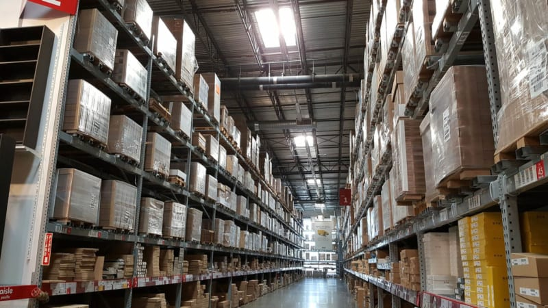 warehouse room with shelves of cardboard boxes wrapped in bale ties